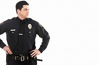 Male police officer standing with hands on hips