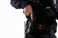 Male police officer reaching for his holster