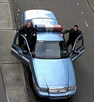 High angle view of male police officers smiling by patrol car