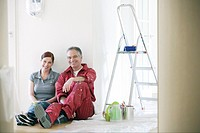 Couple resting during painting