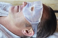Mature man wearing eye mask