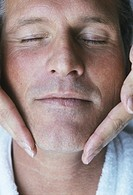 Mature man getting facial massage