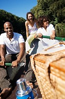 Family in boat smiling and laughing