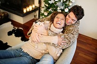 Couple hugging on couch (thumbnail)