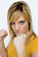 Young woman with fists up, readying to fight (thumbnail)