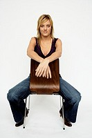 Young woman sitting in chair (thumbnail)
