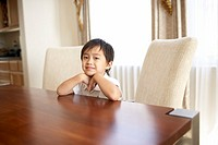 Young boy sitting at the table