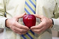 Businessman holding apple