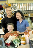 African family in grocery store check-out