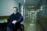 Older man in hospital wheelchair (thumbnail)