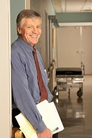 Male doctor standing in corridor
