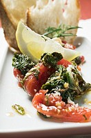 Chard and tomatoes with lemon and white bread