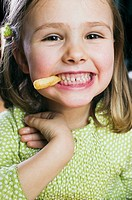 Small girl eating a chip
