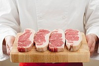 Sirloin steaks on wooden board