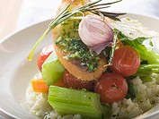 Risotto with vegetables, crostini, pesto and rosemary