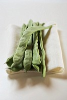 Green beans on linen cloth