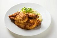 Half a roast chicken with potato salad