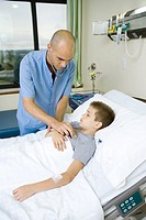 Doctor listening to child´s chest with stethoscope