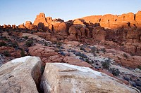 Sandstone fins catch the last rays of winter sunlight in the Fiery Furnace, Arches National Park, Utah, USA