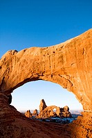 Turret Arch framed through North Window at sunrise, Arches National Park, Utah, USA