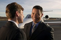 Men talking near airplane