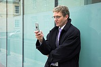 Young businessman using a mobile phone.