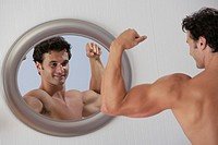 Man flexing in front of mirror
