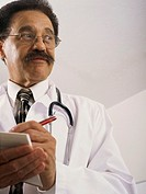 Doctor Writing Out Prescription for Patient