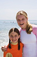 Pre-teen girl and girl at the beach