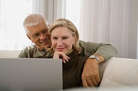 Senior couple using laptop computer