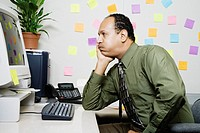 Bored office worker seated at desk