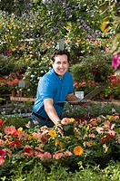 Florist taking inventory in nursery