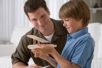 Father and son building a model airplane