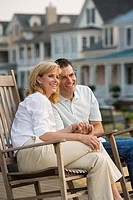 Man and woman sitting in rocking chairs