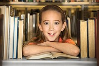 Girl looking through library shelf