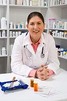 Pharmacist with pill bottles