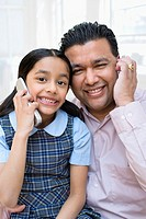Father and daughter with cell phones