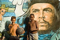 Che Guevara mural. Children playing football. Baracoa. Guant&#225;namo province. Cuba