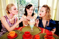 Three young women eating ice cream