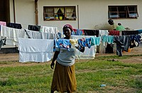 Mother's (most likely) hang the washing on clotheslines near the Howard Hospital Children's Ward in Zimbabwe. The mothers (most likely) have children ...
