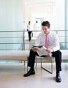 A businessman reading a paper