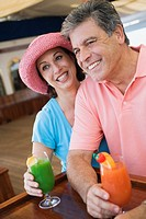 Couple having tropical drinks at bar