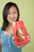 Woman offering red packet