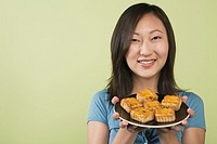 Woman offering plate of hors d'oeuvres