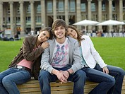 Germany, Stuttgart, young people sitting on bench