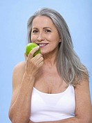 Woman holding green apple, portrait
