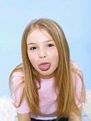 Girl 6-7, tongue out, portrait