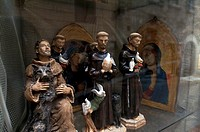 Close-up of statues in a display cabinet of a store, St  Francis Of Assisi, Assisi, Umbria, Italy