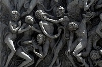 Close-up of statues on a cathedral wall depicting purgatory and hell, Duomo Di Orvieto, Orvieto, Umbria, Italy