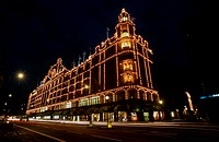 Department store lit up at night, Harrods Department Store, Knightsbridge, London, England